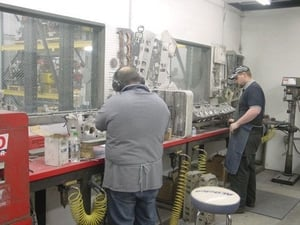 This picture shows our cylinder head porting room. We have 3 cylinder head porters full time.