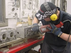 Lee Latozke is shown porting a set of DRCE II heads. Lee is one of our cylinder head specialist and head porter. Lee has a vast knowledge of head porting and has worked on about every kind of cylinder head imaginable. He also does a lot of prototype work and head flow development.