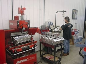 Mark Shisler is shown here preparing the valve guides on a stack of 12° Schmidt Pro-Filer heads.