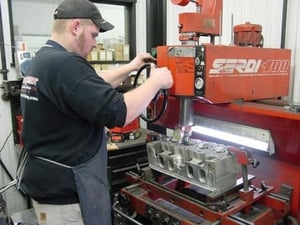 In this picture Lee Latozke is shown working with a set of DRCE II heads. Lee is one of our cylinder head specialist and head porter. Lee has a vast knowledge of Racing Cylinder Head preparation.