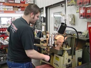 Darin Morrison shown working on our Sunnen Valve Grinding Machine.
