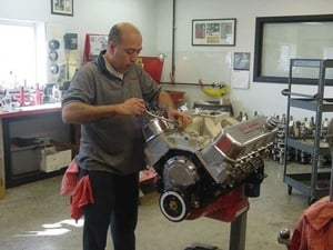 Roberto Bergeron is one of our engine assemblers and is shown here doing a final assembly on one of our 565 engines. Roberto has worked for us assembling engines for over 10 years.