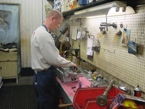 Greg Walford is shown here assembling a over-head cam cylinder head for one of our many automotive customers.