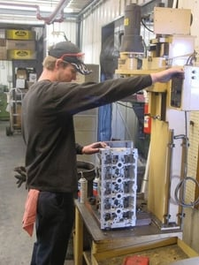 Brad Cain is shown here setting up an over-head cam cylinder head to bore the cam saddles for new cam bearings.